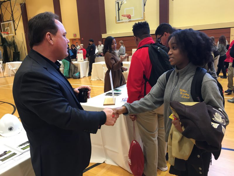 Alumni and students connect at the MHS Career Fair.