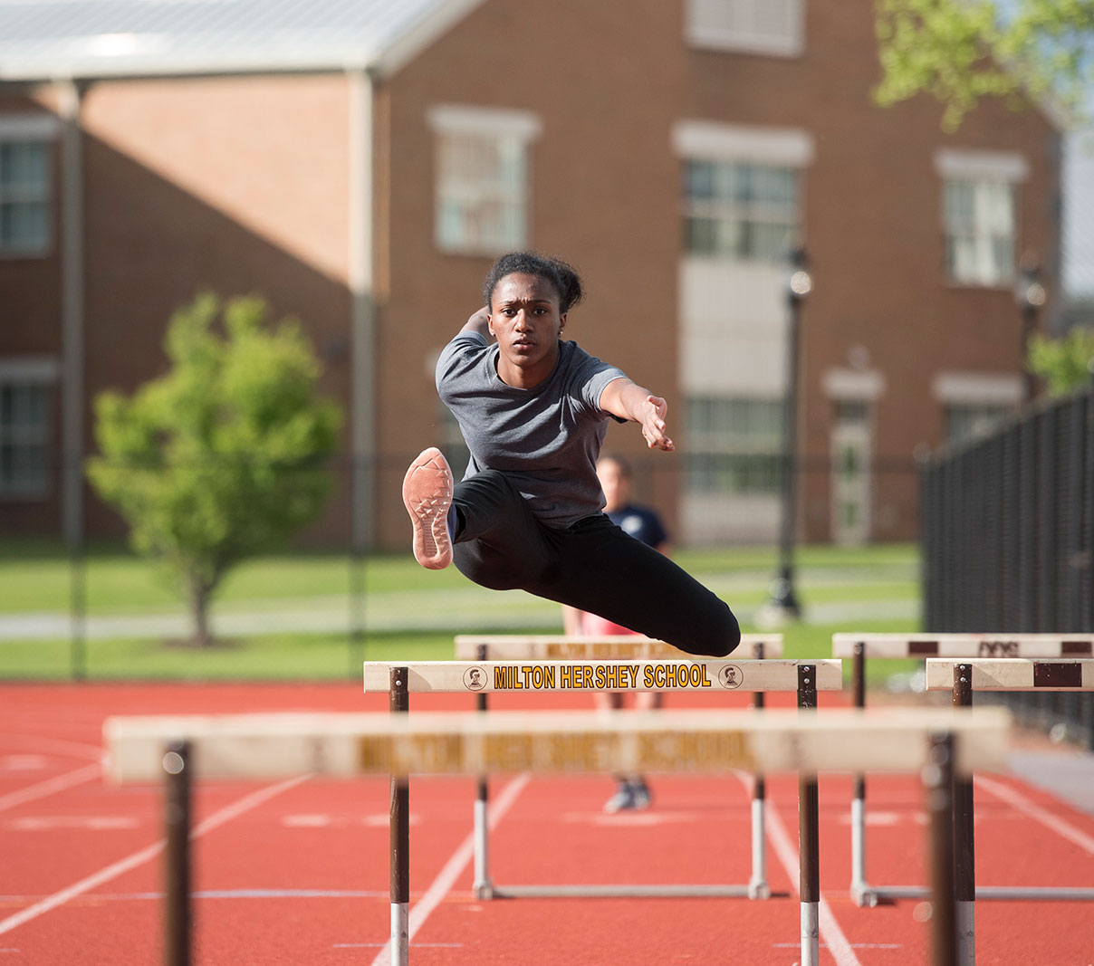 MHS athlete jumping hurdles